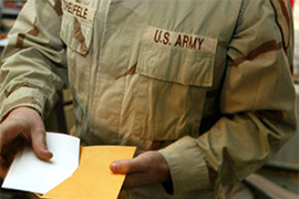 military personnel holding ballot